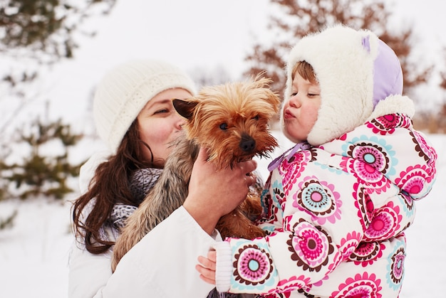 A little girl kisses a dog with love Free Photo