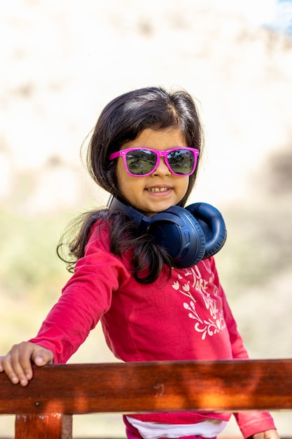 Little girl listening to music with her headphones in the truck car Premium Photo