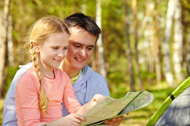 Little girl looking at a map with her father Free Photo