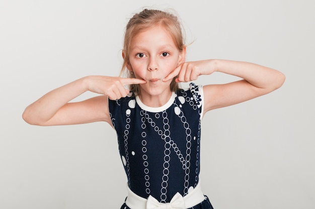 Little girl making foolish expression Free Photo