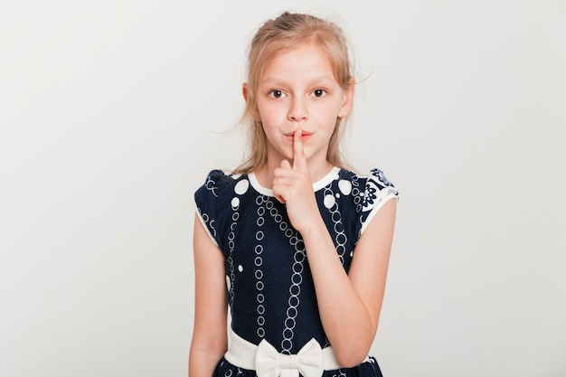 Little girl making gesture of silence Free Photo