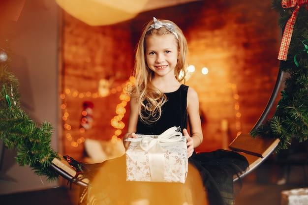 Little girl near in a black dress Free Photo