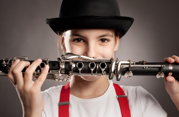 Little girl playing clarinet Premium Photo