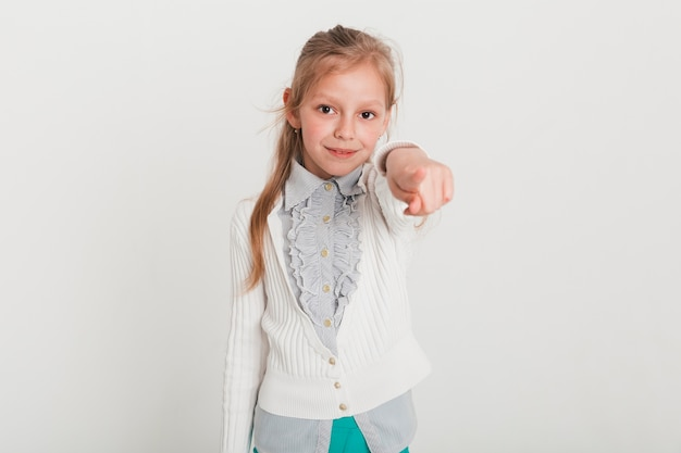Little girl pointing towards you Free Photo