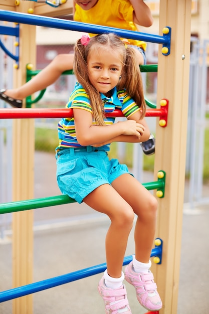 Little girl resting on the playground Free Photo