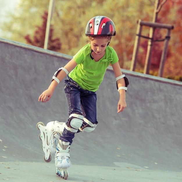 Little girl on roller skates Premium Photo