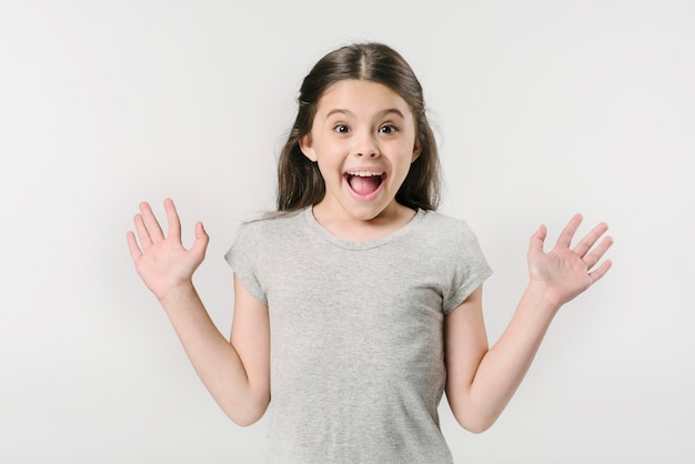 Little girl screaming with excitement in studio Free Photo