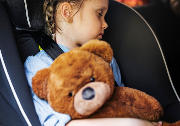 Little girl sleeping in the car Premium Photo