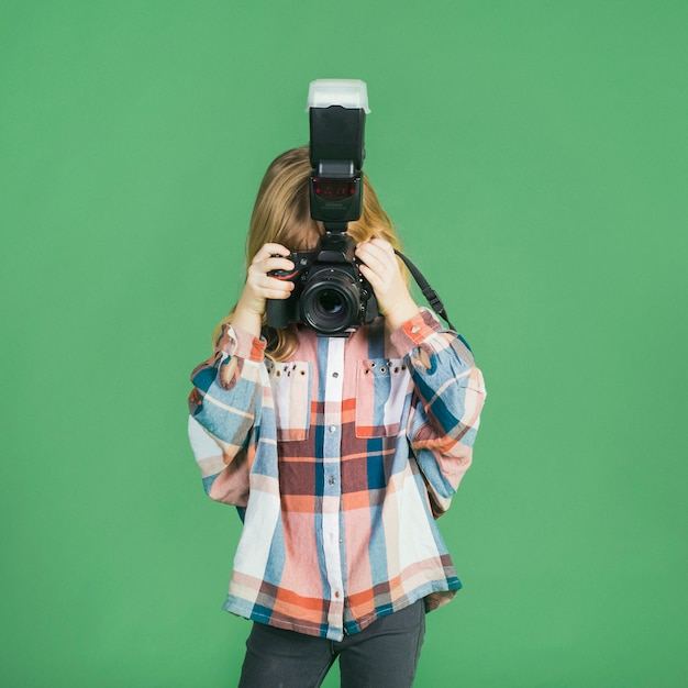 Little girl taking picture with camera Free Photo