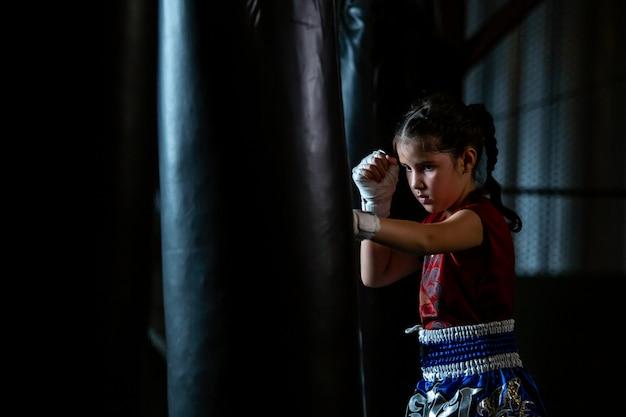 Little girl thai boxing training is a self defense course, muay thai. Premium Photo