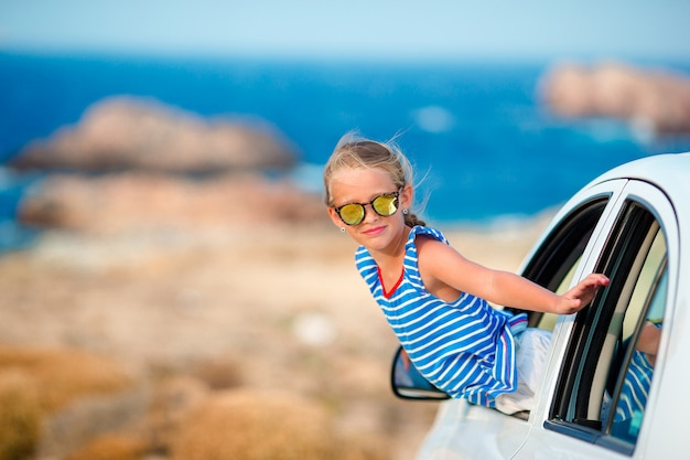 Little girl on vacation travel by car background beautiful landscape Premium Photo