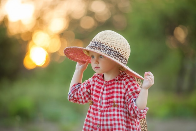 Little girl in the village for a walk in the summer Premium Photo
