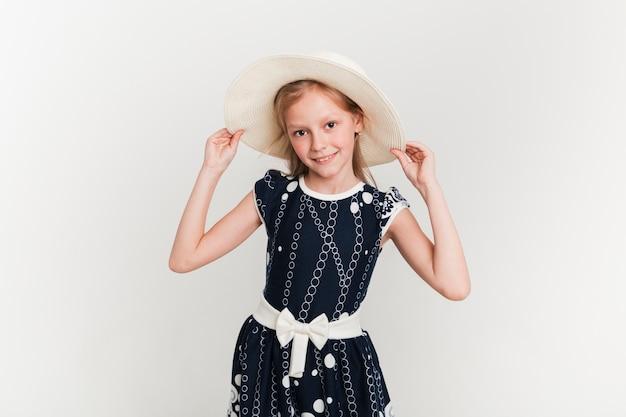 Little girl wearing summer hat Free Photo