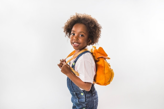 446cff70a935 Little girl with backpack in studio Photo | Free Download