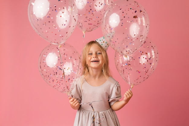 Little girl with balloons in costume Premium Photo