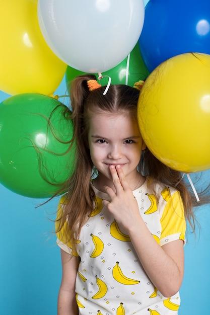Little girl with balloons Premium Photo
