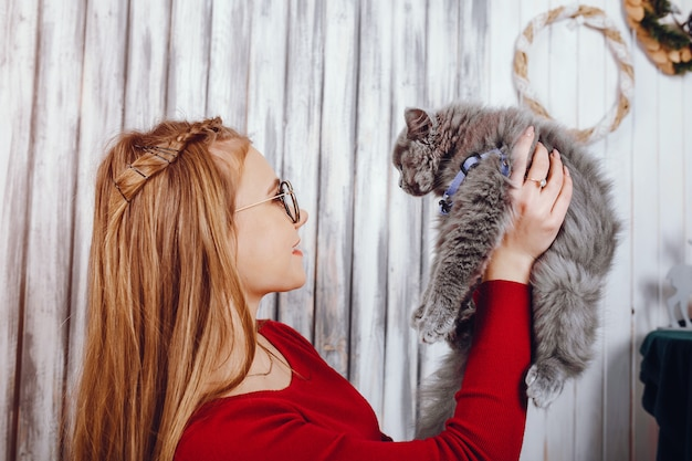 Little girl with cat Free Photo
