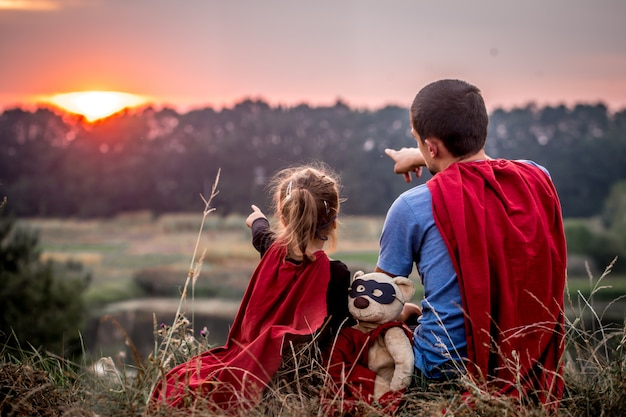 Little girl with dad dressed in super heroes, happy loving family Free Photo