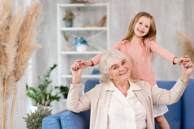 Little girl with grandma at home Premium Photo