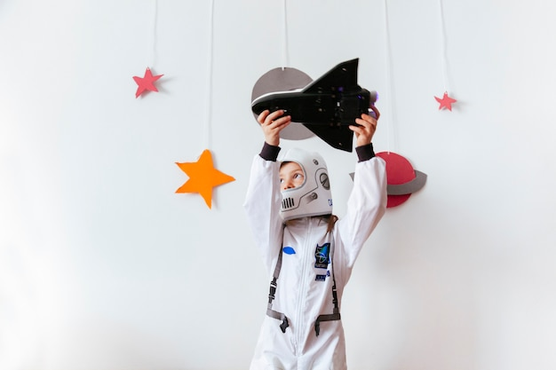 Little girl with love for astronomy Premium Photo