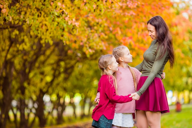 Little girl with mom outdoors in park at autumn day Premium Photo