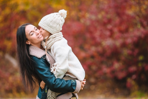 Little girl with mom in park at autumn day Premium Photo