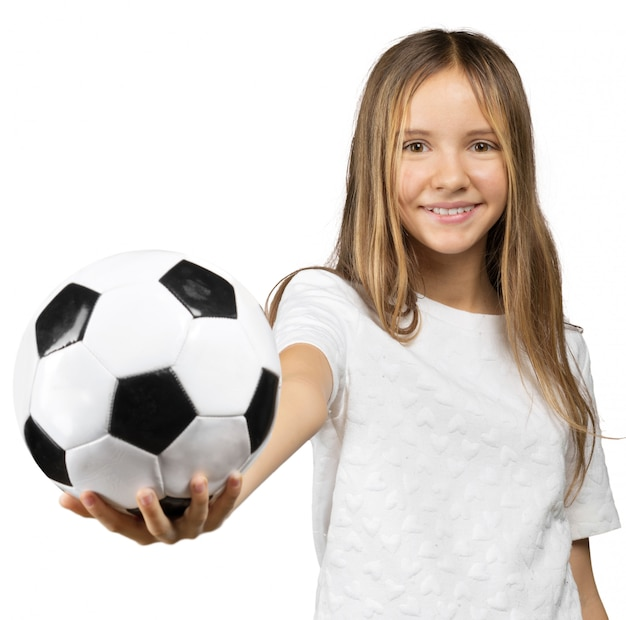 Little girl with a soccer ball isolated on a over white background Premium Photo