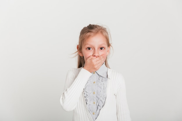 Little girl with surprised expression Free Photo