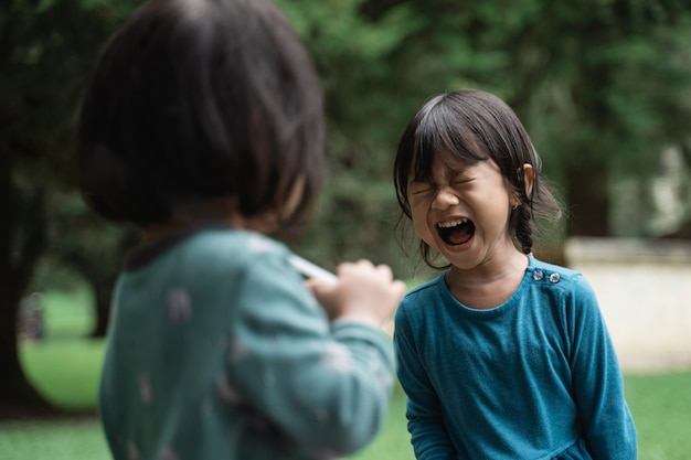 Little girls crying sad and angry Premium Photo