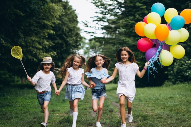 Little girls friends with balloons in forest Free Photo