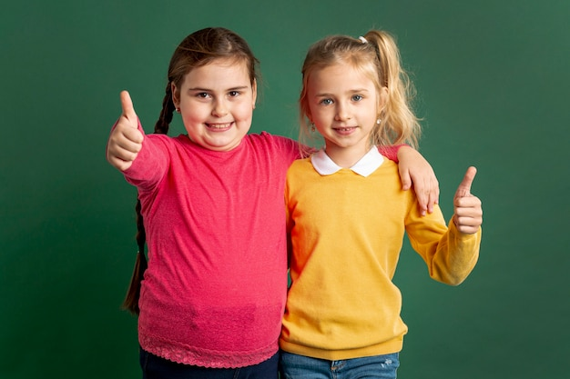 Little girls showing ok sign Free Photo