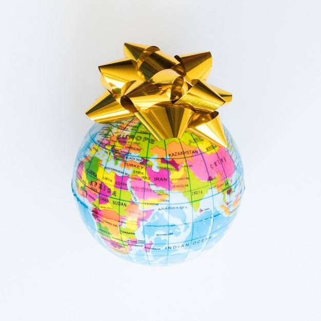 Little globe with bow Free Photo