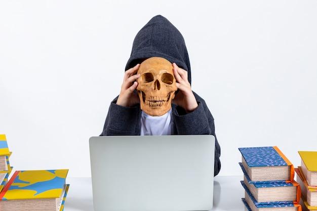 Little hacker boy with laptop Free Photo