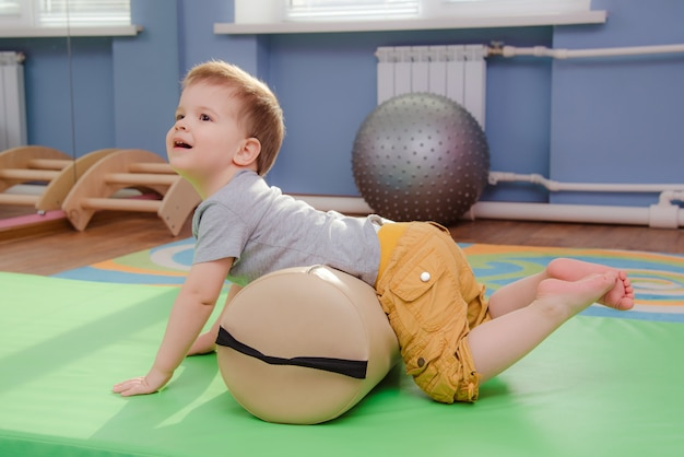 Little kid is engaged in sports in the gym Premium Photo
