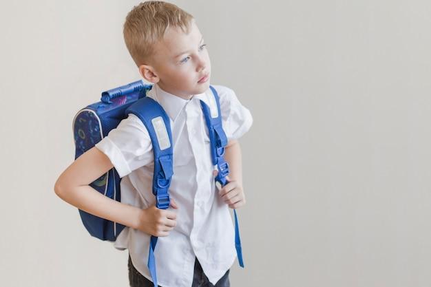 Little kid with rucksack in studio Free Photo
