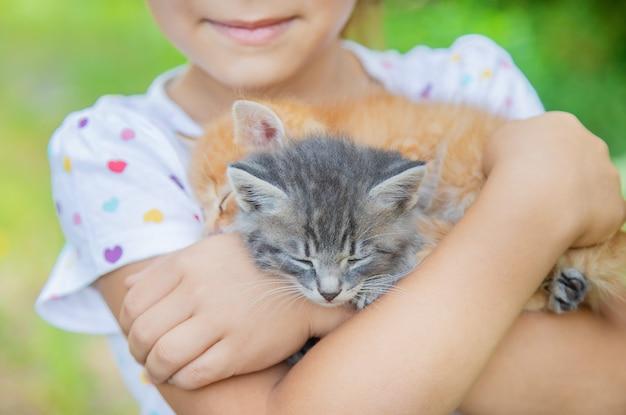 Little kittens in the hands of children Premium Photo