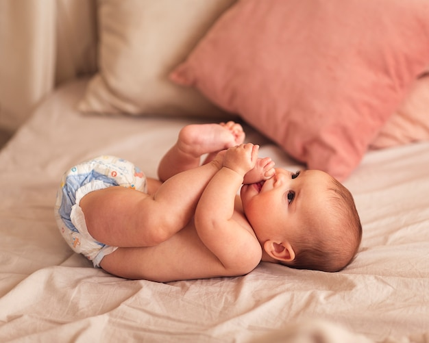 Little newborn baby being playful Premium Photo