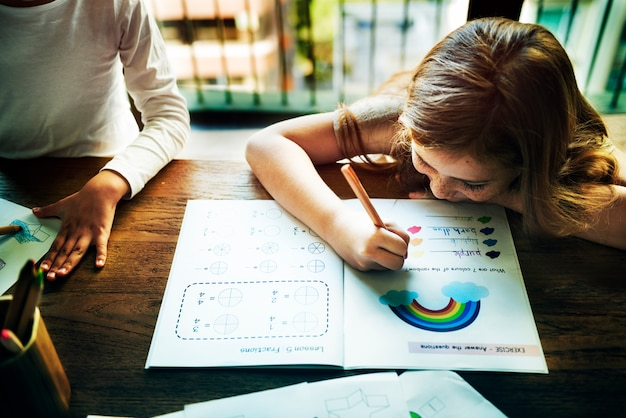 Little preschoolers writing acitivity concept Premium Photo