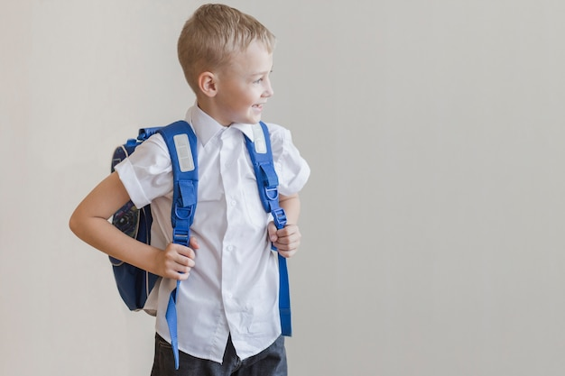 Little pupil with backpack in studio Free Photo