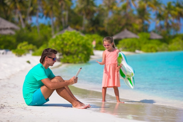 Little sad girl waiting for dad to swim until he working Premium Photo