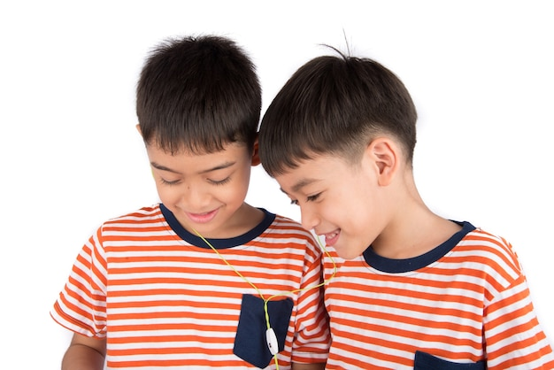 Little sibling boy playing game on mobile together Premium Photo