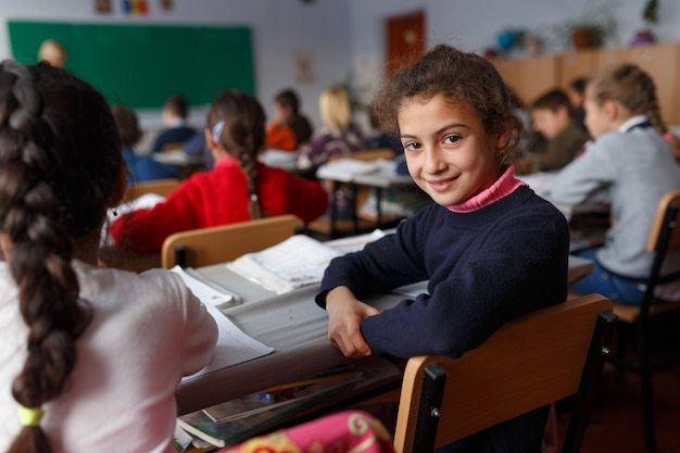 Little student happy to be back to school Premium Photo