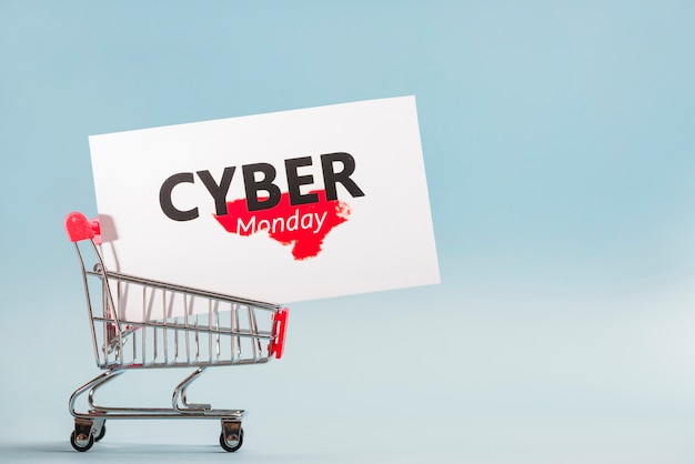 Little supermarket cart with big label Free Photo
