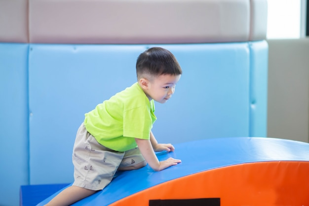 Little toddler boy working out at the indoor gym excercise Premium Photo