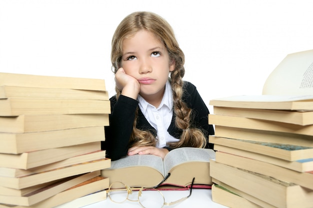 Little unhappy sad student blond braided girl bored with stacked Premium Photo