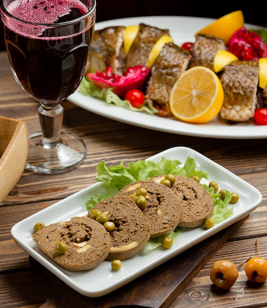 Liver pate and a glass of pomegranate juice Free Photo