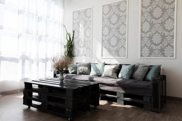 Living room design with a comfy couch Free Photo