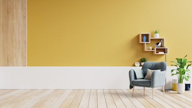 Living room interior with fabric armchair ,lamp,book and plants on empty yellow wall background. Premium Photo