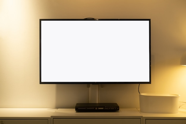 Living room led blank screen tv on concrete wall with wooden table and media player Premium Photo