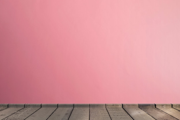 Living room in pink tones wall interior parquet wood floor with copy space Premium Photo